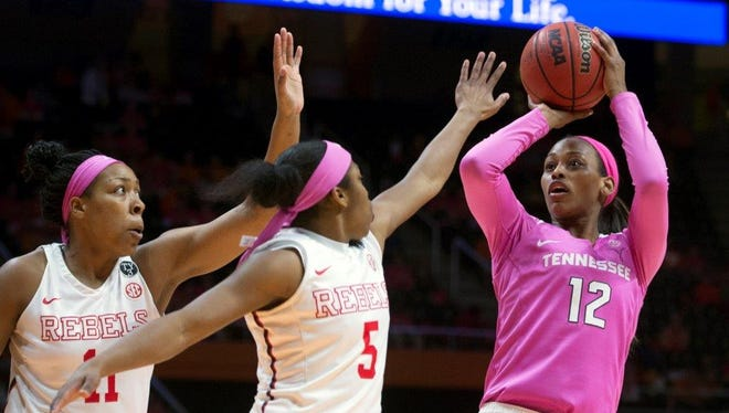 Tennessee's Bashaara Graves attempts to score while defended by Mississippi's Erika Sisk, right, and Shequila Joseph on Feb. 18, 2016.