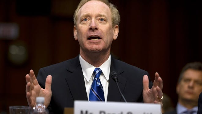 Microsoft president Brad Smith, shown here testifying on Capitol Hill in 2013, announced during Thursday Hill testimony that Microsoft would be filing an amicus brief in support of Apple, which is battling the FBI's court order to create a back door entrance to the iPhone of a San Bernardino killer.