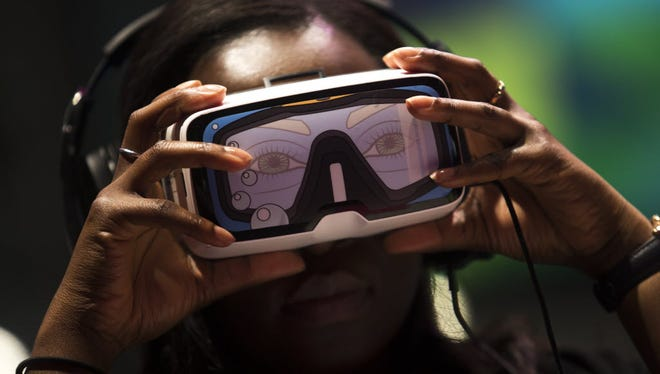 A visitor to Mobile World Congress in Barcelona tries on a virtual-reality headset, one of a coming wave of VR devices.