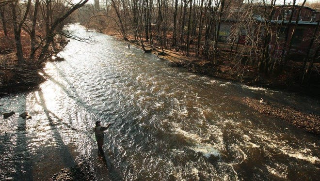 Anglers try the Rockaway River for trout in this 2014 file photo.