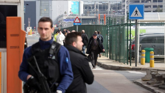 Police stand guard as passengers are evacuated from Zaventem Bruxelles International Airport after a terrorist attack on March 22, 2016 in Brussels, Belgium.