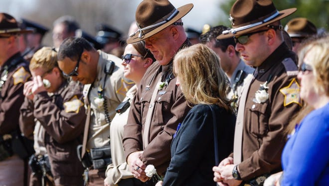 Friends and colleagues of Howard Co. deputy Carl A. Koontz get emotional during the final call.