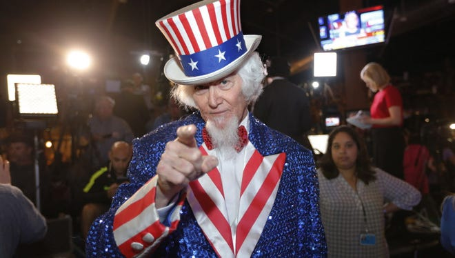 John Evans dressed as Uncle Sam of Kingwood, Texas, a supporter of Republican presidential candidate, Sen. Ted Cruz (R-TX), attends a Super Tuesday watch party at the Redneck Country Club March 1, 2016 in Stafford, Texas.