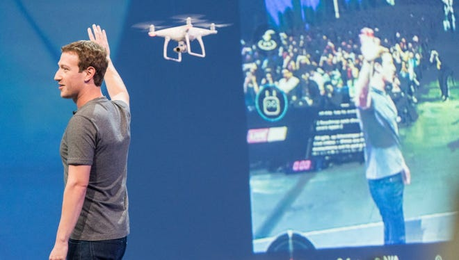 Facebook CEO Mark Zuckerberg, on stage at the f8 developer conference, shows a drone that was live streaming video. Zuckerberg used the platform to criticize a divisive political climate.