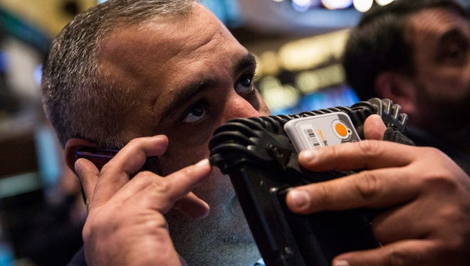 A trader works on the floor of the New York Stock Exchange during the afternoon of January 27, 2015 in New York City.