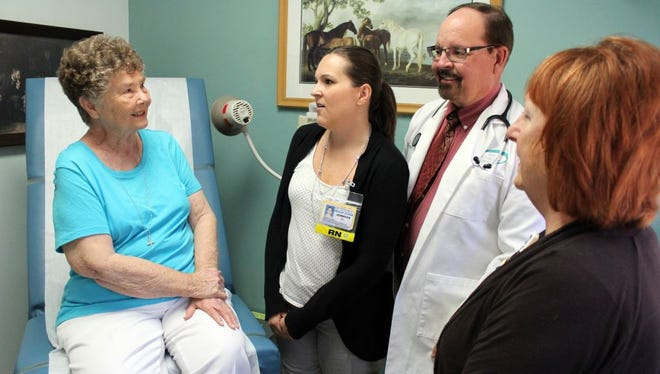 Gail Balesky, 81, of Cape Coral, visits with Jennifer Turza, RN, Care Coordinator, Gregory Krill, M.D., and Annie Frey, RN, Care Coordinator, who have helped manage her long-term diabetes care.