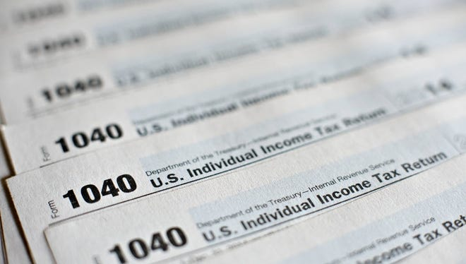 1040 Individual Income Tax forms, photographed March 16, 2015.