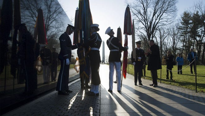 Color guards prepare for a March 29 wreath-laying ceremony at the Vietnam Veterans Memorial Wall in Washington.