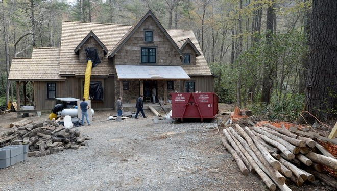 Stone work and interior work continues on a log cabin-style home in the Lonesome Valley gated community outside of Cashiers on Monday, April 25, 2016.