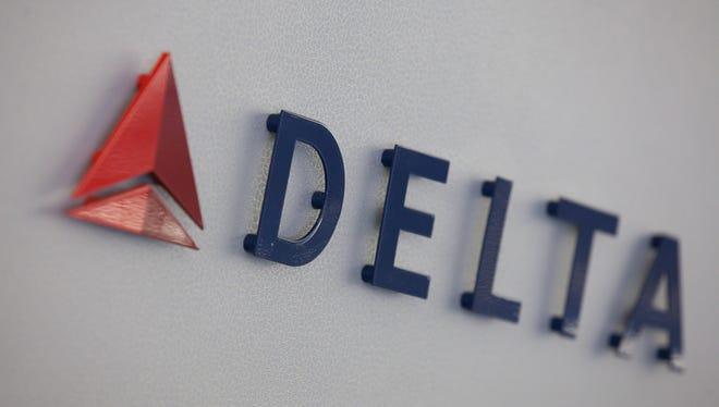 Delta Air Lines' logo, seen inside an Airbus A330 long-haul jet, at Atlanta Hartsfield-Jackson International Airport on April 29, 2016.