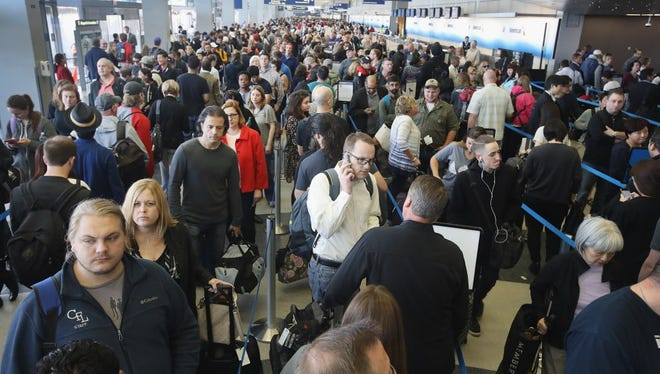 Passengers at O'Hare International Airport wait in line to be screened at a Transportation Security Administration (TSA) checkpoint on May 16, 2016 in Chicago, Illinois. Waiting times at the checkpoints today have been reported to be as long 2 hours.