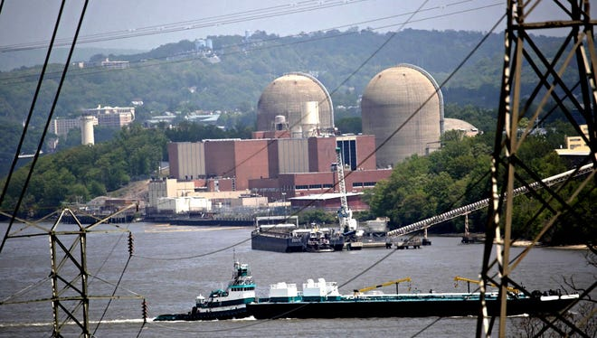 A tanker goes past Indian Point in May 2015 after a transformer explosion and fire at the nuclear power plant released oil into the Hudson River.