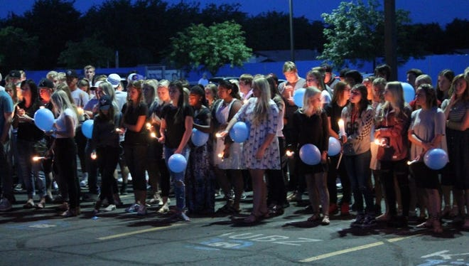 Dixie High School students honor Drex Taylor, an 18-year-old student who died after a rollover crash Sunday on state Route 18 at a candlelight vigil in the high school parking lot. The passenger in the crash, 16-year-old Taylor Carlton, was air-lifted from the vehicle and transported to the nearest hospital in critical condition.