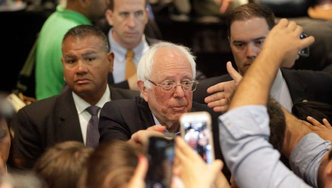 Democratic presidential candidate Sen. Bernie Sanders, I-Vt. shakes hands with supporters after speaking at a rally, Tuesday, May 24, 2016, in Anaheim, Calif.