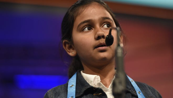 Naysa Modi, 10, of Monroe La., correctly spells 'decillion' in Round 3 of the 2016 Scripps National Spelling Bee at the Gaylord National Resort and Convention Center in National Harbor, Md.