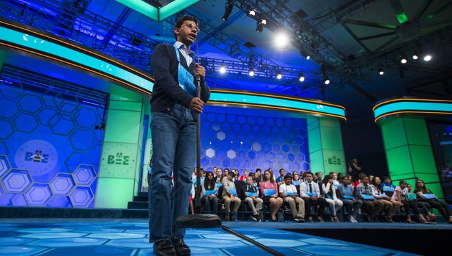 Tharein Potuhera of Nebraska lifts the microphone stand as he correctly spells 'propinquity' during the preliminaries of the Scripps National Spelling Bee at National Harbor, Maryland, USA, 25 May 2016.