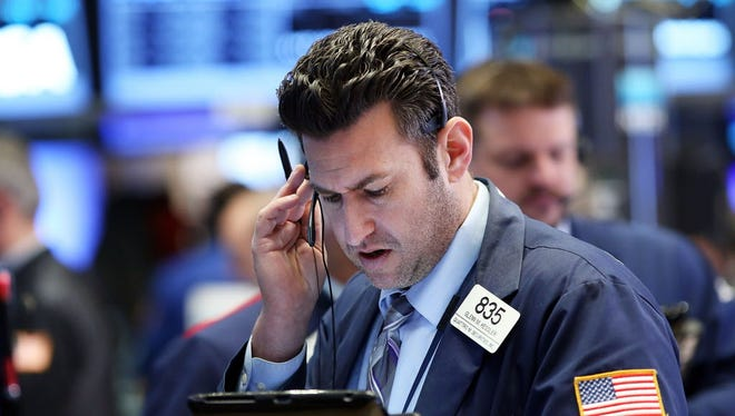 Traders work on the floor of the New York Stock Exchange (NYSE) on March 7, 2016 in New York City.