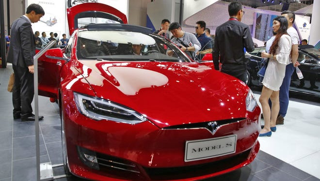 A Tesla model S electric car on display at the Auto China 2016 motor show in Beijing, China.