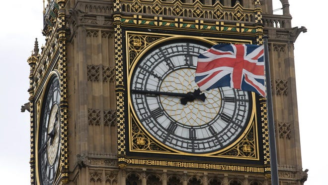 A Union flag flaps in the wind in front of one of the faces of Big Ben in London on June 27, 2016.