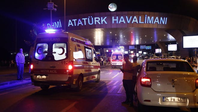 Turkish police block the road Tuesday after a suicide bomb attack at Ataturk Airport in Istanbul.