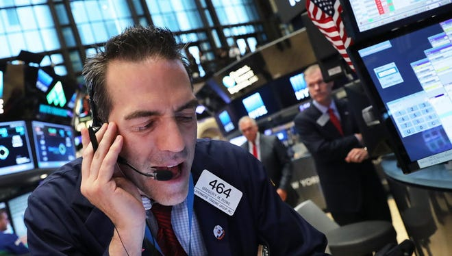 Traders work on the floor of the New York Stock Exchange following news that the United Kingdom voted to leave the European Union.
