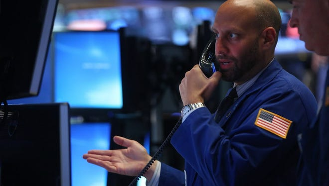 Traders work on the floor of the New York Stock Exchange (NYSE) at the close of the trading day on June 28, 2016 ,in New York City.