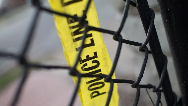 Remnants of crime scene tape remain on a fence in Foster Park following a shooting on April 19, 2016 in Chicago, Ill. The nation's third largest city tallied more than 60 shooting incidents over the Independence Day weekend.