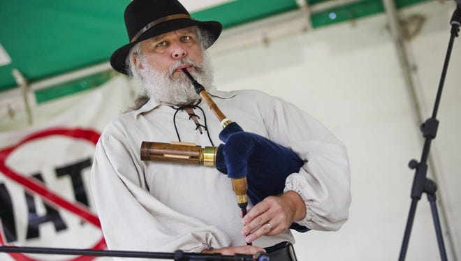 Wayne Morrison, from New Windsor, performs on the shuttle pipe during the 21st annual Adams County Heritage Festival in 2012. The shuttle pipe is similar to the highland bagpipes. Morrison and his wife were performing original Celtic harp and bagpipe music.