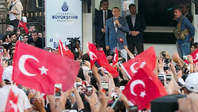 Turkish President Recep Tayyip Erdodan speaks during a rally near his house in Istanbul on July 16, 2016 after Turkish authorities wrested back control of the Ataturk airport.