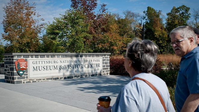 In this file photo from July 2016, visitors make their way to the Gettysburg National Military Park Museum & Visitor Center.