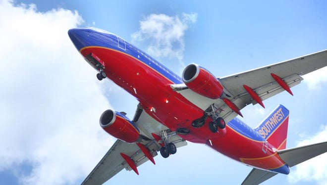 FILE - In a June 6, 2016, file photo, a Southwest Airlines jet gets ready to land at Tampa International Airport, in Tampa, Fla.