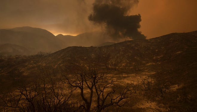 A scorched landscape is left smoldering at the Sand Fire on July 23 2016 near Santa Clarita, California. Fueled by temperatures reaching about 108 degrees fahrenheit, the wildfire began yesterday has grown to 11,000 acres.