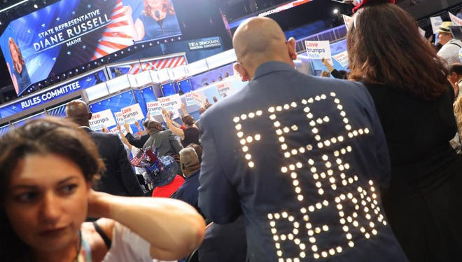 """In a July 25, 2016, photo, Sanjay Patel of Satellite Beach wears a """"Feel the Bern"""" jacket on the Democratic National Convention floor at the Wells Fargo Center in Philadelphia, Pennsylvania."""