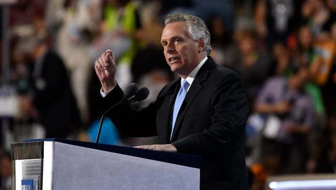 Virginia Gov. Terry McAuliffe takes the stage during the Democratic National Convention at Wells Fargo Arena in Philadelphia on July 26, 2016.