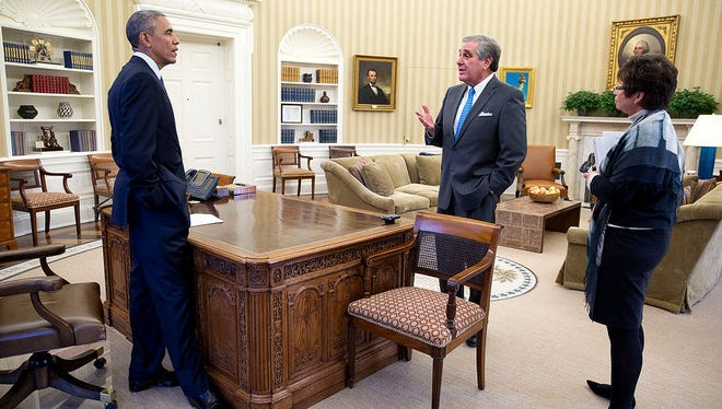 President Barack Obama meets with Jerry Abramson, director of intergovernmental affairs, and senior adviser Valerie Jarrett in the Oval Office, Nov. 18, 2014. (Official White House Photo by Pete Souza)