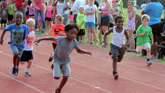 Youngsters enjoy the thrill of the race at the GWTC Summer Series in this file photo. The month of June kicks off with the return of the Summer Track Series at Maclay.