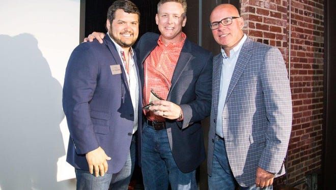 Pictured are Estates Homes General Manager Eric Coulter, HomesPlus Owner / CEO Jeff Foote, and Clayton Homes Regional Vice President of Manufacturing Britt Richards.