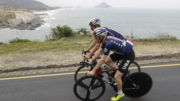 United States' Brent Bookwalter, bottom, and Taylor Phinney ride along the coast during their training Aug. 7 at the 2016 Summer Olympics in Rio de Janeiro, Brazil