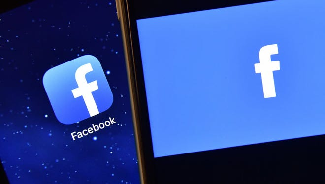 The Facebook logo displayed on an iPad and on an iPhone.