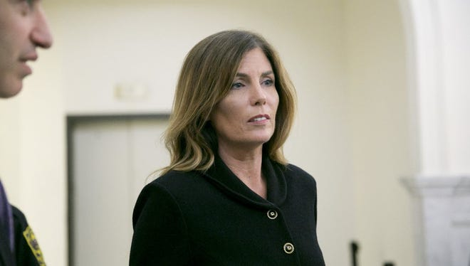 Pennsylvania Attorney General Kathleen Kane leaves the courtroom after closing arguments in her perjury and obstruction trial at the Montgomery County Courthouse, Monday, Aug. 15, 2016, in Norristown, Pa.