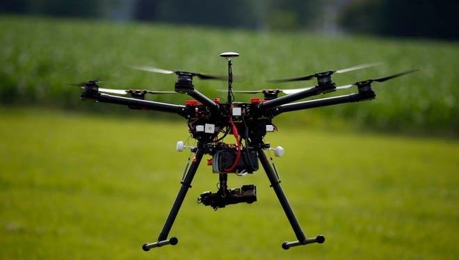 A hexacopter drone is flown June 11, 2015, during a drone demonstration at a farm and winery on potential use for board members of the National Corn Growers in Cordova, Md.