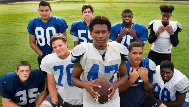 Eastside Quarterback TJ Gist is surrounded by teammates Jack Beehler, Eduardo Esparza, Will Posey, JoJo Fernandez, Deshawn Sullivan,  Will Posey, Chance Pride, and Michael Gladden during practice on Tuesday, August 2, 2016.
