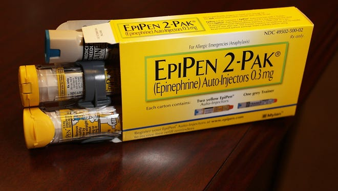 EpiPen medication, which dispenses epinephrine through an injection mechanism for people with severe allergies.