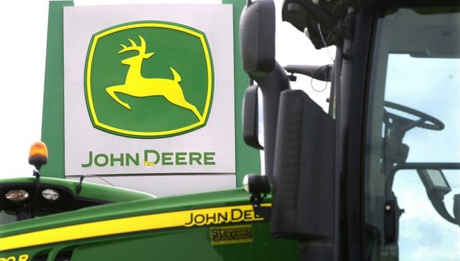 John Deere farming equipment at a dealership in Petersburg, Ill.