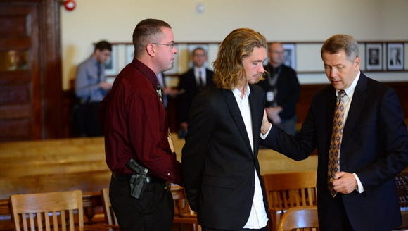 Jesse Helt, center, speask to his attorney Whitney