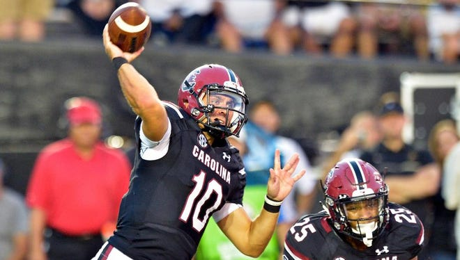 South Carolina Gamecocks quarterback Perry Orth (10) passes during the first half against the Vanderbilt Commodores at Vanderbilt Stadium.