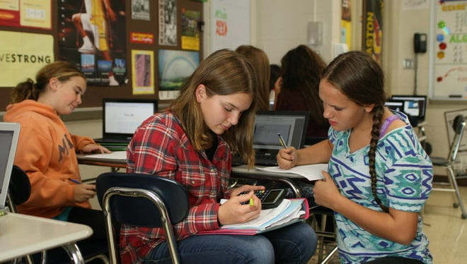 Eighth-graders Hannah Therauilt, left, and Taylor Tantaquidgeon, Oct. 9, 2015, Thomaston, Conn.