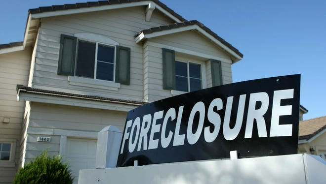 A foreclosure sign sits in front of a home for sale April 29, 2008 in Stockton, California.