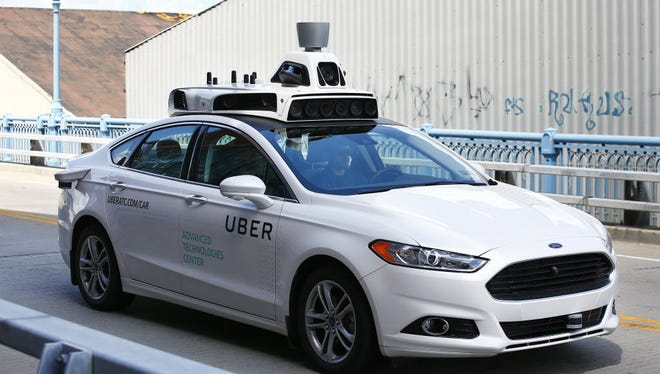 Uber tests a self-driving Ford Fusion hybrid car in Pittsburgh.