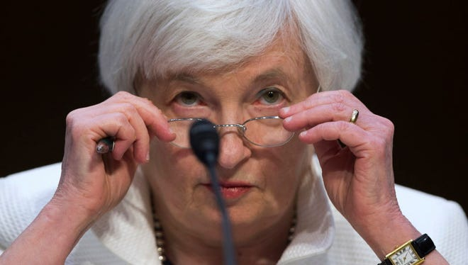 Federal Reserve Chairman Janet Yellen adjusts her glasses as she testifies on Capitol Hill in Washington on June 21, 2016, before the Senate Banking Committee.